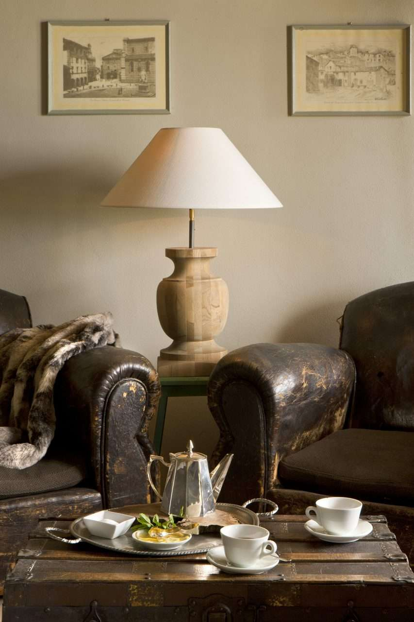Clubs chairs fur throws and rugs with vintage touches